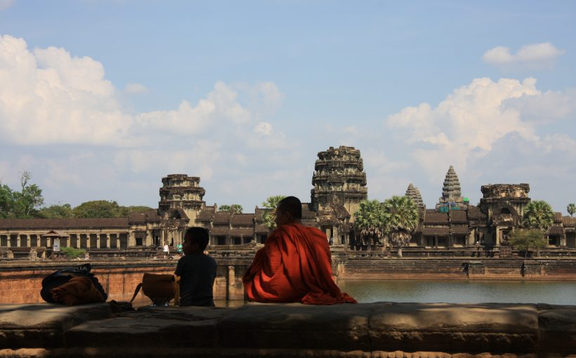 Priest in front of Angkor Wat